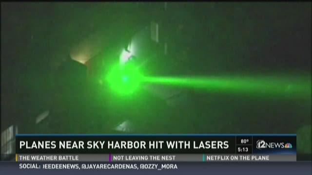 The FAA says two flights heading toward Phoenix Sky Harbor Thursday night were hit by a green laser. November 13, 2015.
